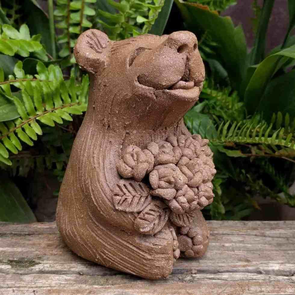 sitting_bear_flowers_outside_greenspace_11