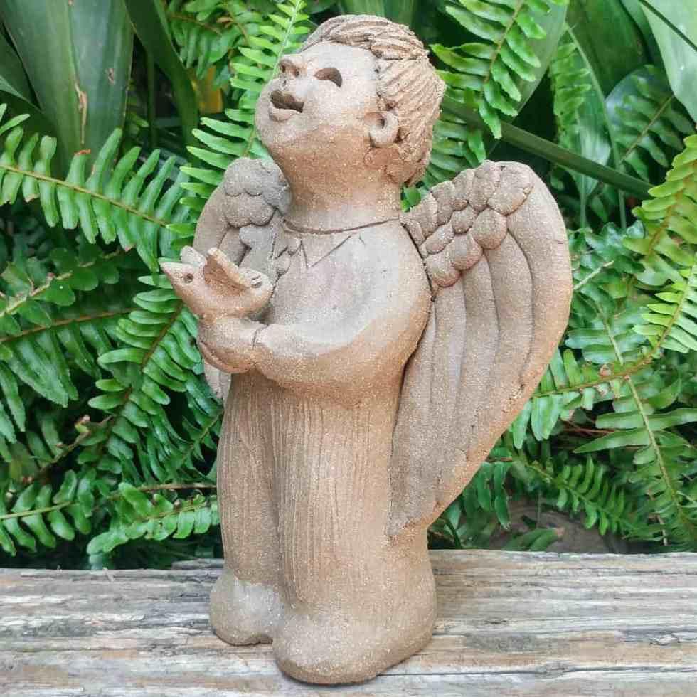 clay-angel-boy-holding-bird-small-garden-figurine-by-margaret-hudson-earth-arts-studio-1