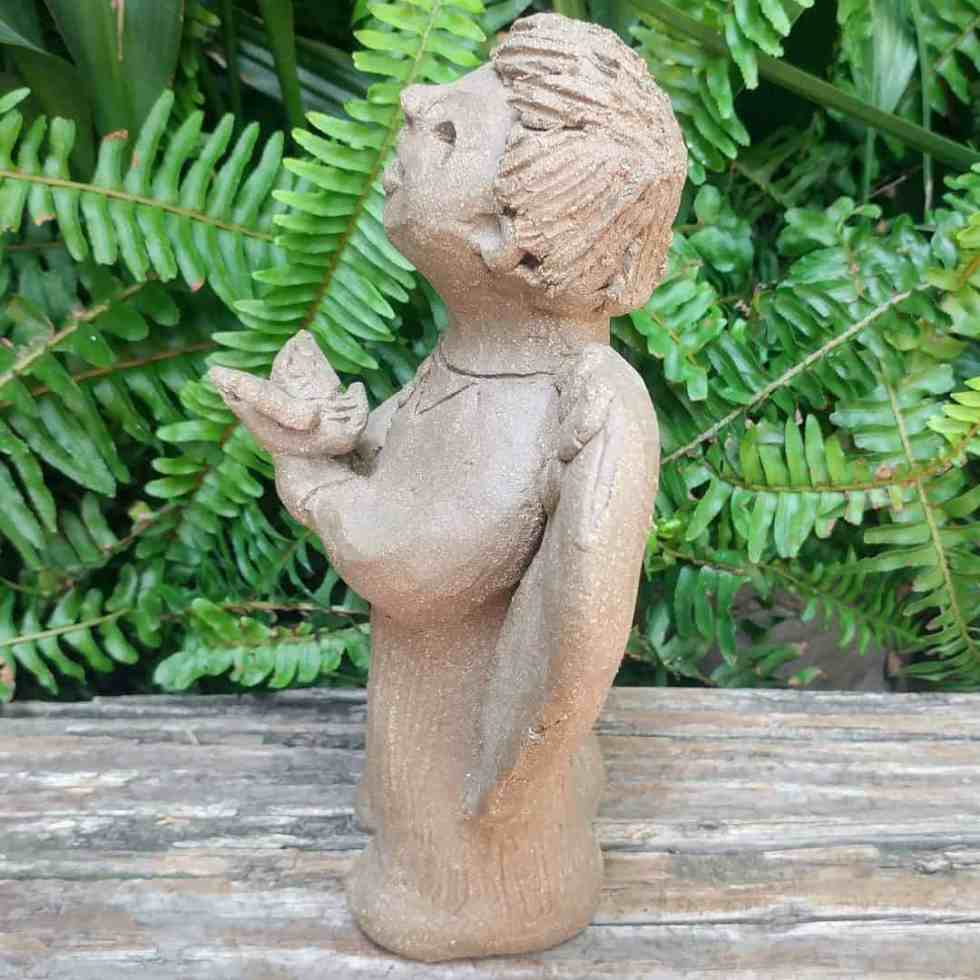 clay-angel-boy-holding-bird-small-garden-statue-by-margaret-hudson-earth-arts-studio-0