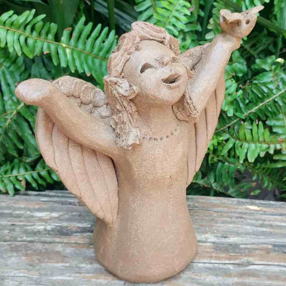 pottery-angel-girl-praising-bird-in-hand-outdoor-statue-by-margaret-hudson-earth-arts-studio-2