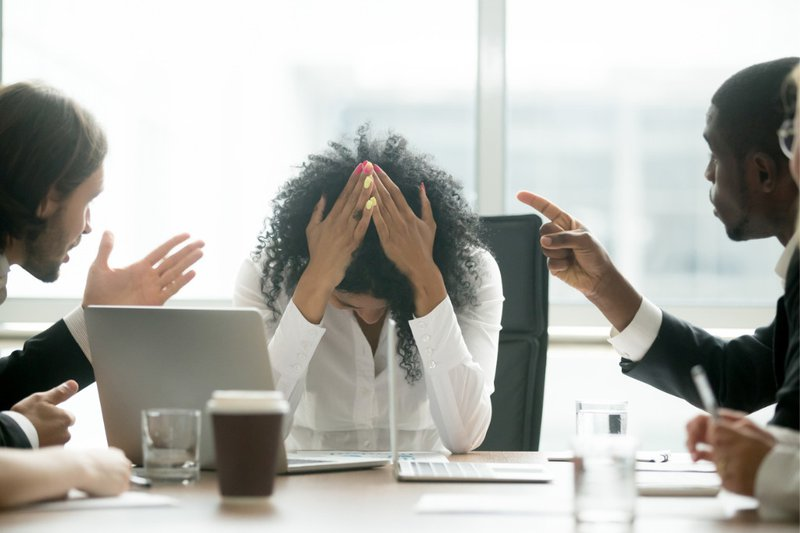 Women Holds Head During Meeting Argument