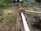 Capped this mainline drain pipe with notched logs.