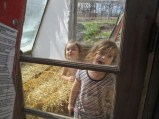 The girls playing in the greenhouse before I put the trays in.