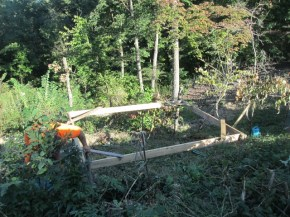 Built the frame, squared it, then brought it down to where we wanted it. Then we figured out where to dig the holes, set the posts and mounted the frame to the posts. This seems to be the best way to build critter houses on this slope.