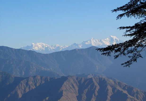 A photo of snowcapped Himalayas in the far distance, seen from Mussoorie, UP India