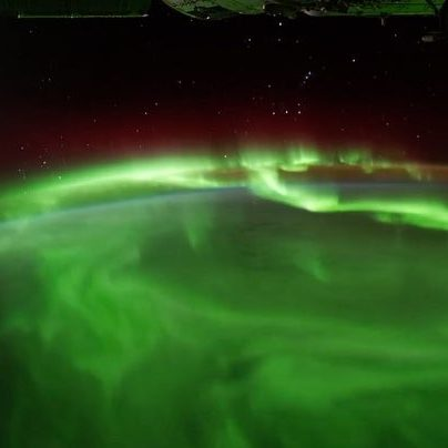 Photograph from space of Northern Lights / Aurora Borealis over the Earth