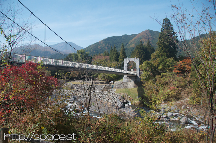 Dainichi Bridge and autumn leaves and Nantai in the far left background