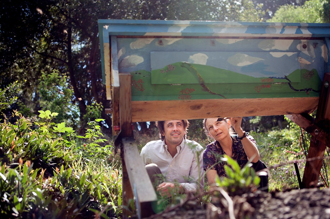 Dr. Kegley shows Loarie a bee box in the backyard of her home in California.