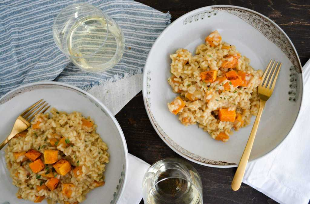 butternut squash risotto with glass of wine