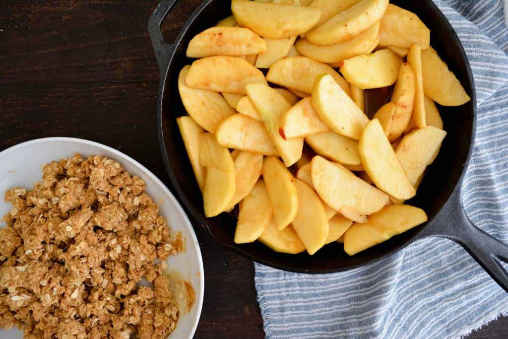Bowl of streusel and a skillet of apples