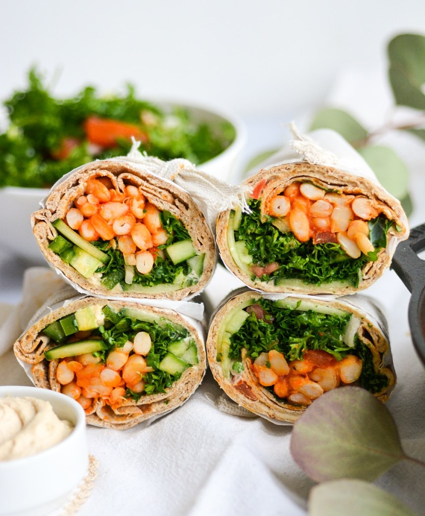 pita bread sandwiches filled with vegan white bean filling