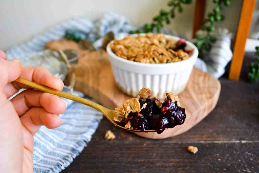 Close up of bite of healthy berry crisp for one