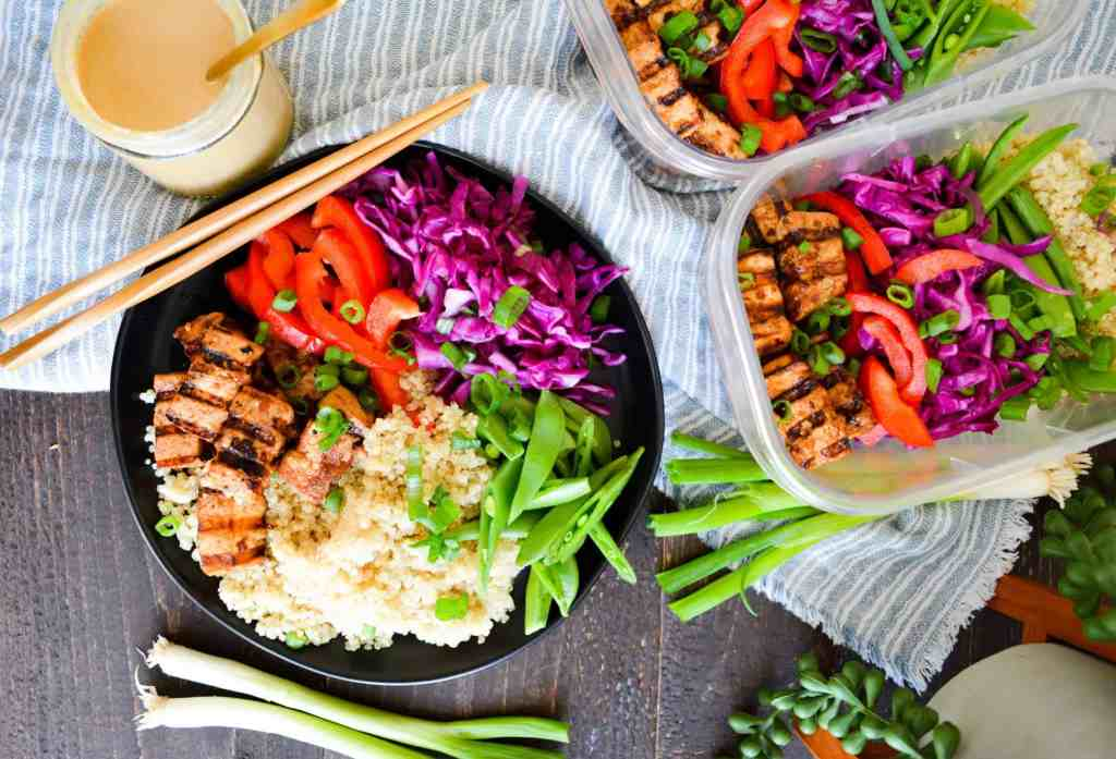 Thai tofu grain bowls, meal prepped and plated