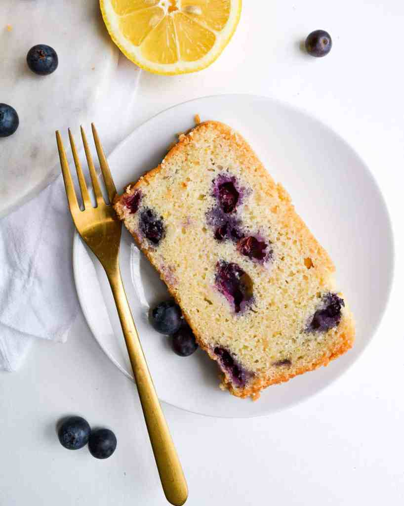 Close up of a slice of blueberry lemon bread