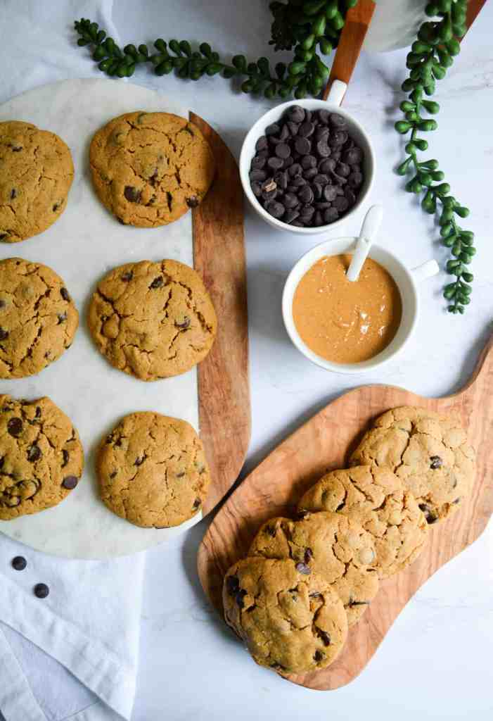 Peanut Butter Chocolate Chip Cookies on a marble board and wooden board