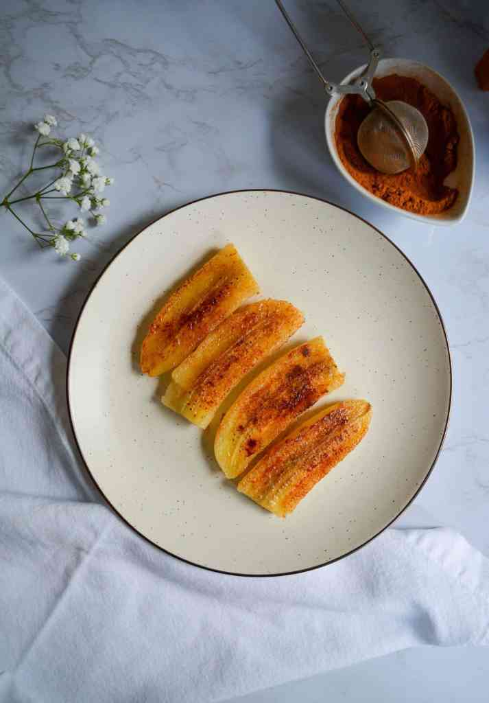 Caramelized banana slices on a plate