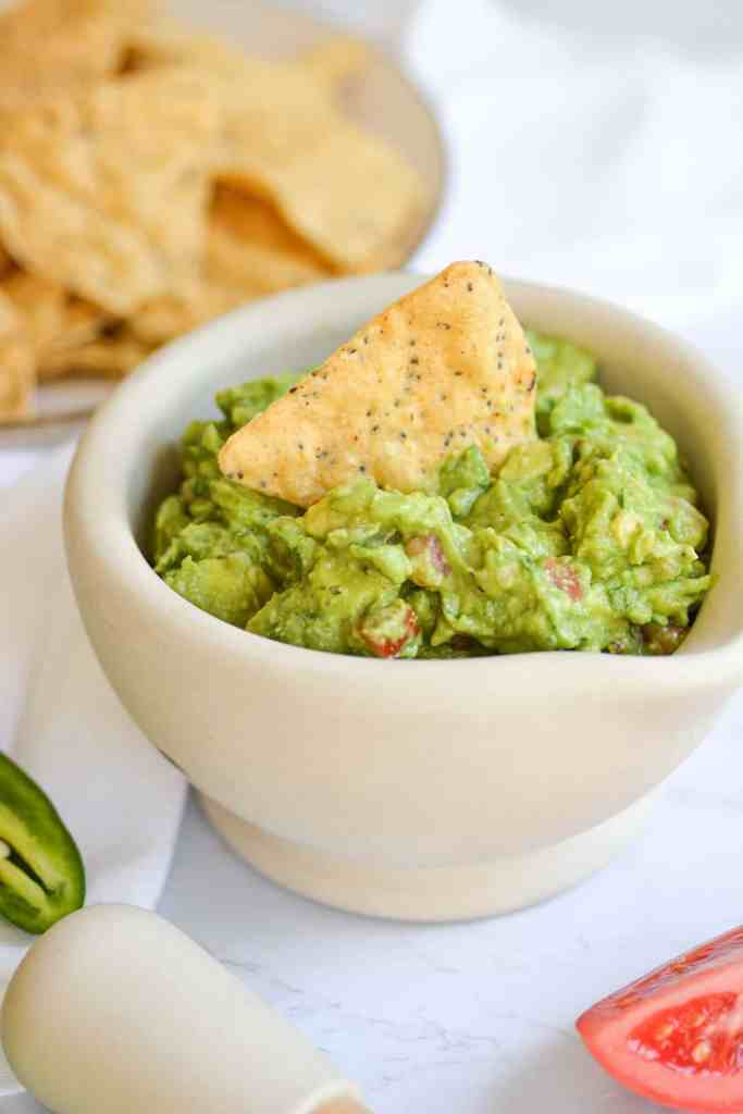 Close up of Easy and Chunky Guacamole in a mortar