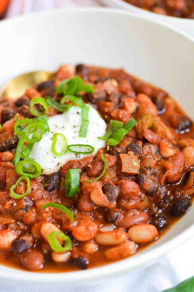 Close up of a bowl of Chili topped with sliced scallion