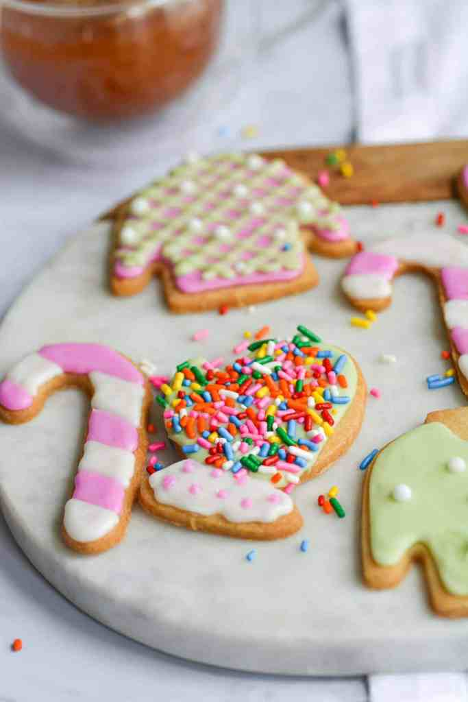 close up of a sugar cookie mitten with rainbow sprinkles