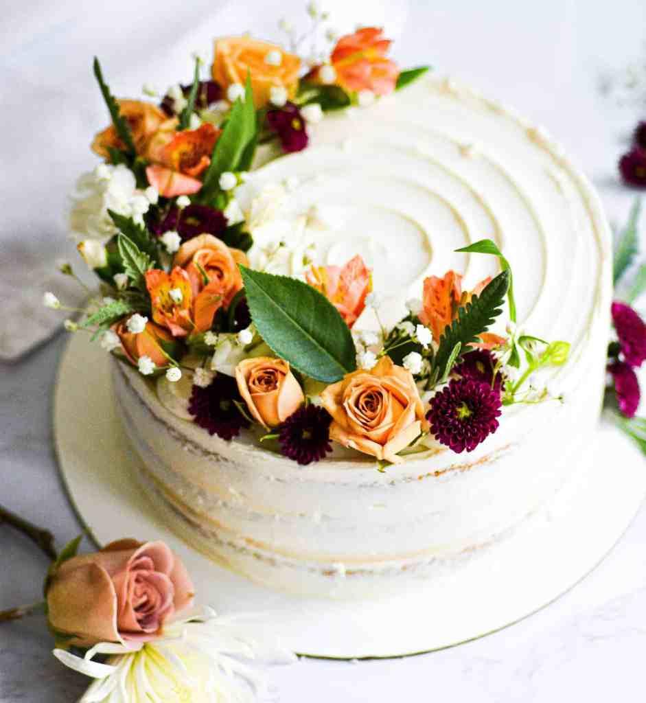 Vanilla vegan wedding cake with flowers for a Boston wedding