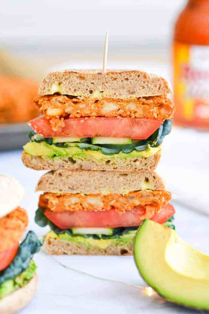 Buffalo Chickpea Burger cross section stacked on top of each other