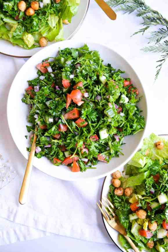 a white bowl filled with grain-free tabbouleh salad