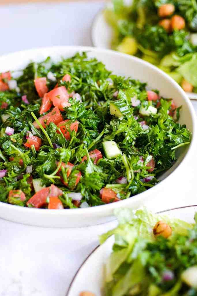 A white bowl filled with Tabbouleh