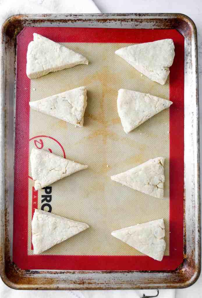 triangular scones on a sheet tray
