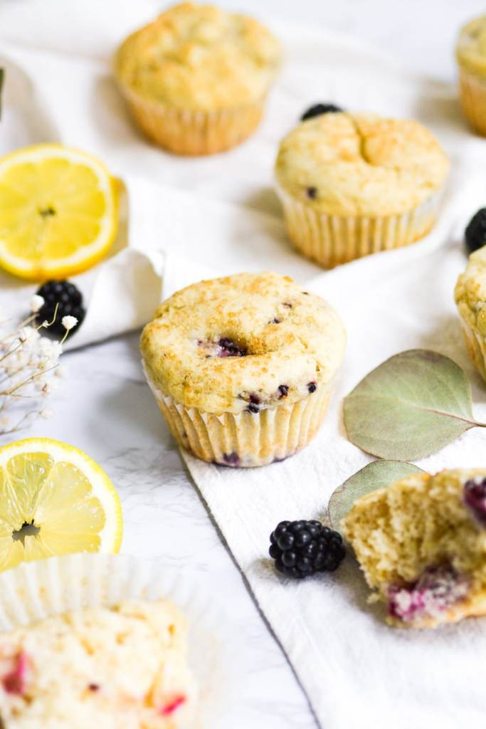 portrait of a vegan blackberry muffin on a white board