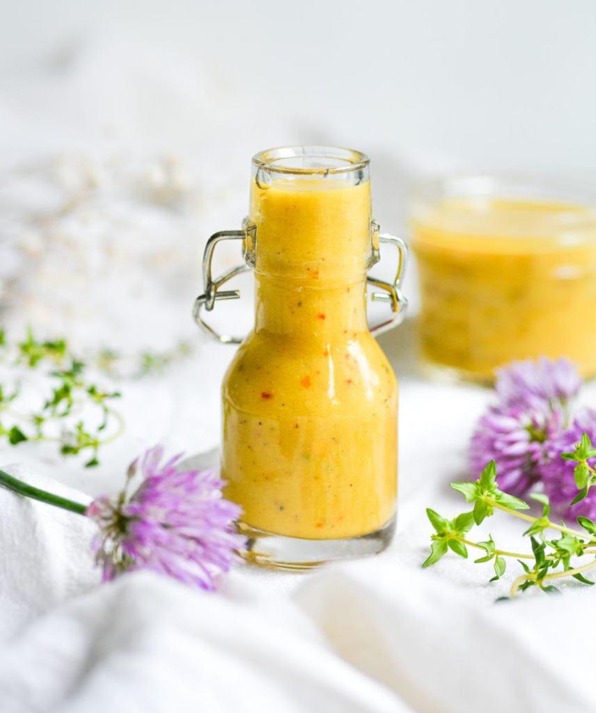 Vegan Honey Mustard Dressing in a small jar