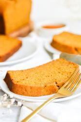 A slice of vegan banana pumpkin bread on a plate