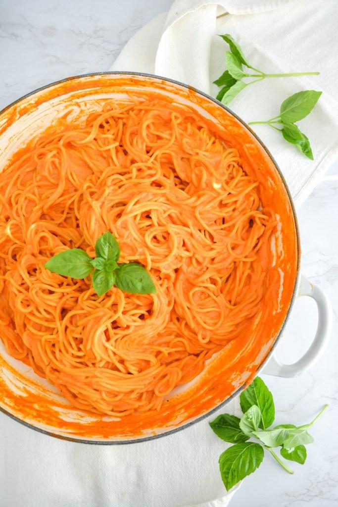 A large shallow pot with Vegan Creamy Tomato pasta