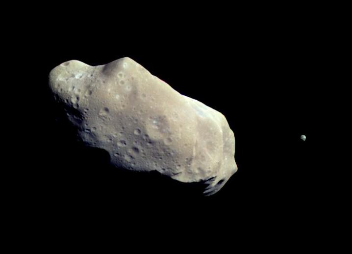 Asteroid 243 Ida and its tiny moon Dactyl
