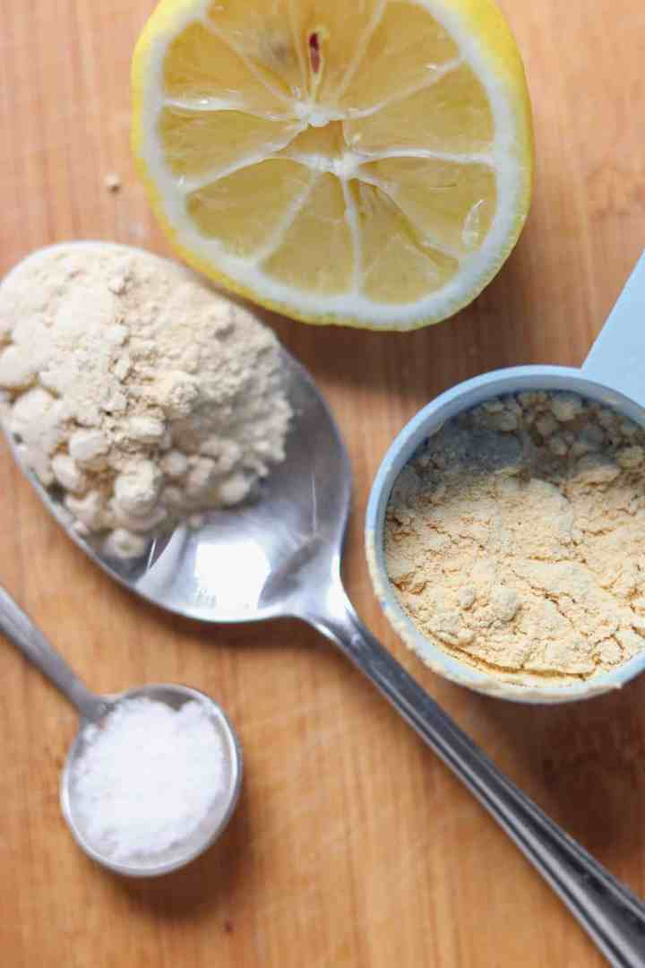 A spponful of maca powder, a scoop of protein powder, pink Himalayan salt and half a lemon
