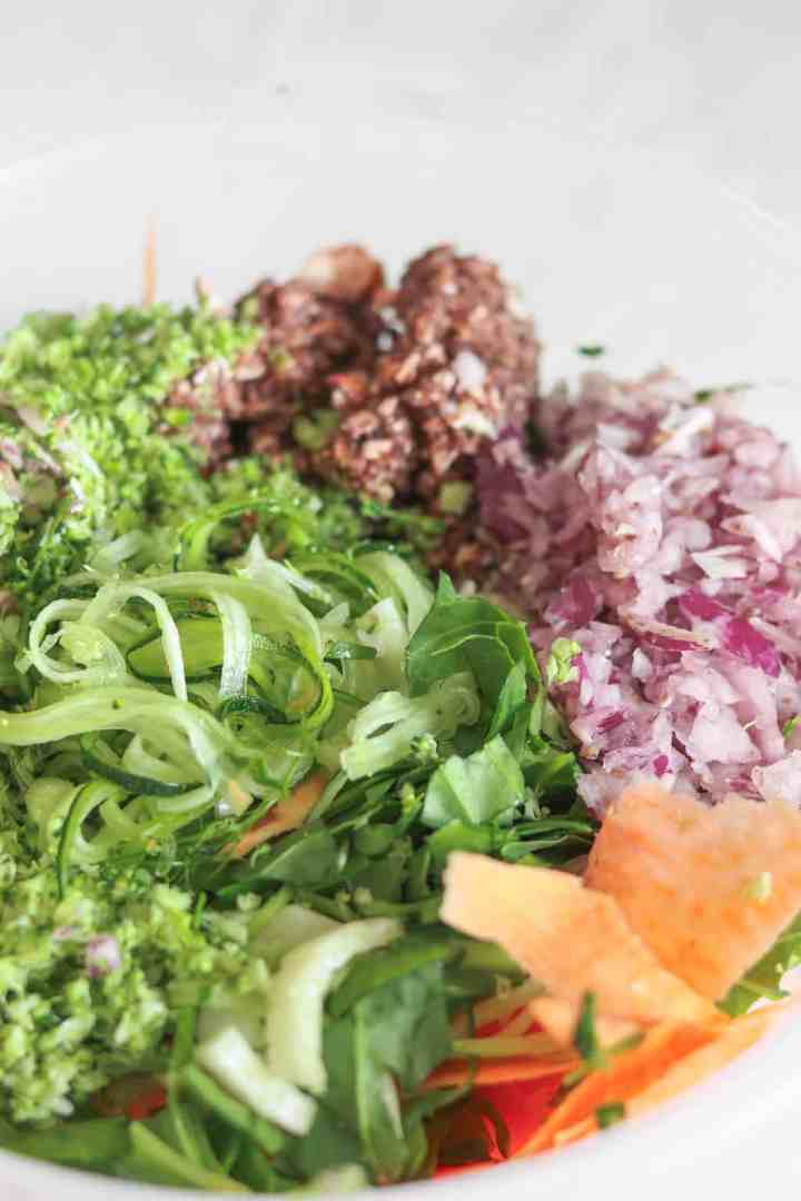 Raw vegetable salad with zucchini noodles, spiralized sweet potato, red onion, mushrooms and broccoli