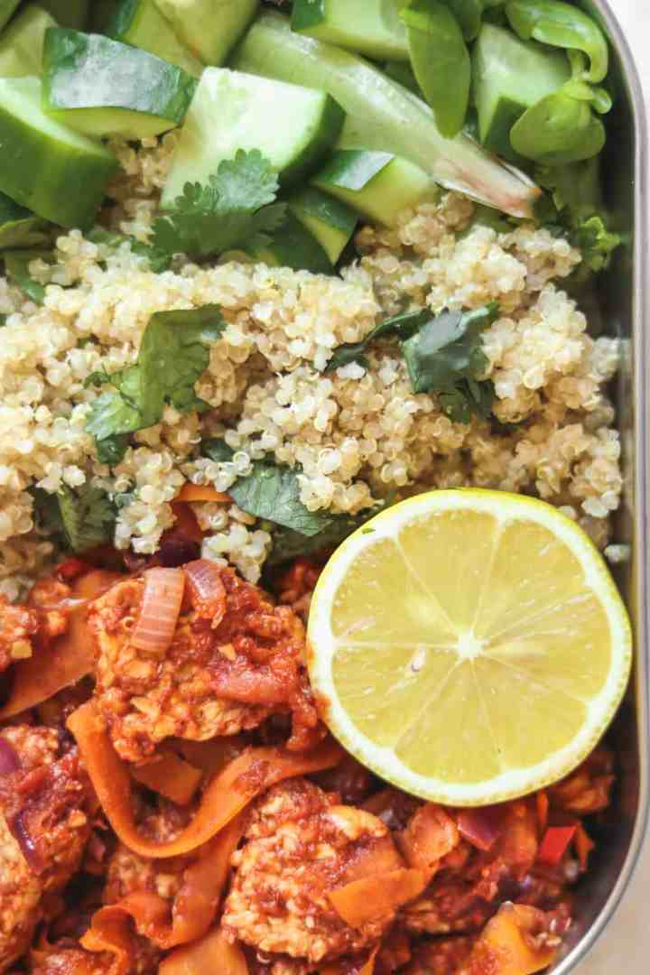 Vegan meal prep quinoa and tempeh in tomato sauce