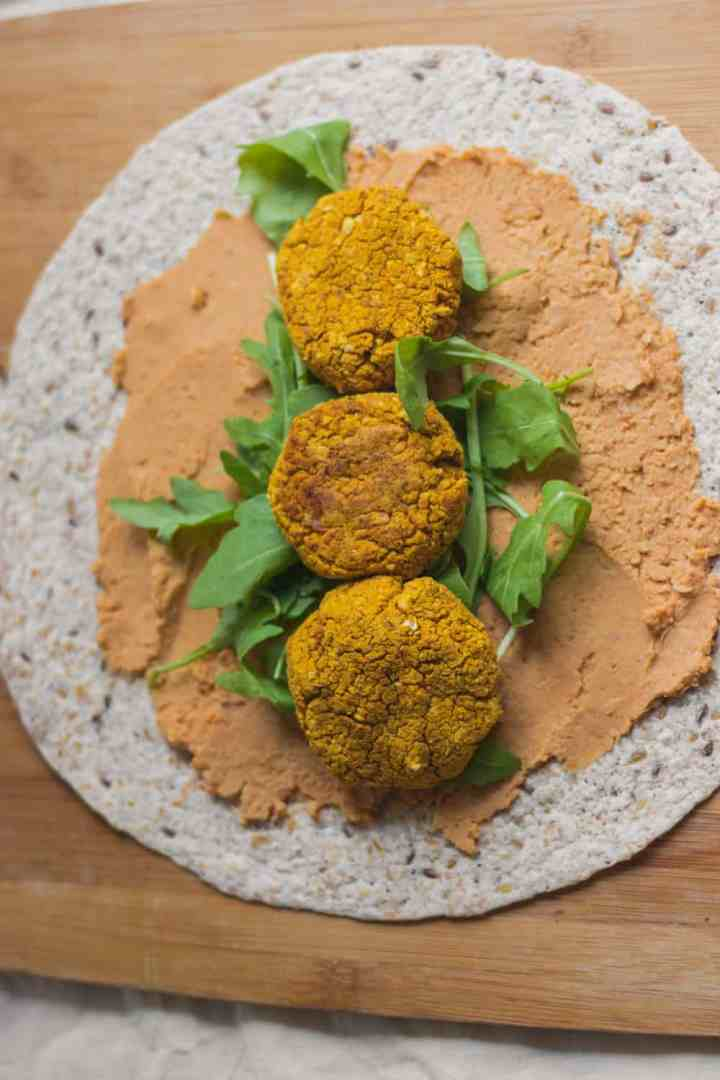 Tortilla with hummus, baked falafels and arugula