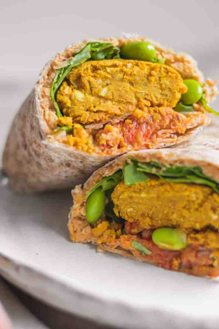 Vegan wraps with baked falafels, hummus and vegetables