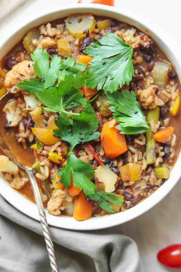 Vegan rice soup with black beans and vegetables