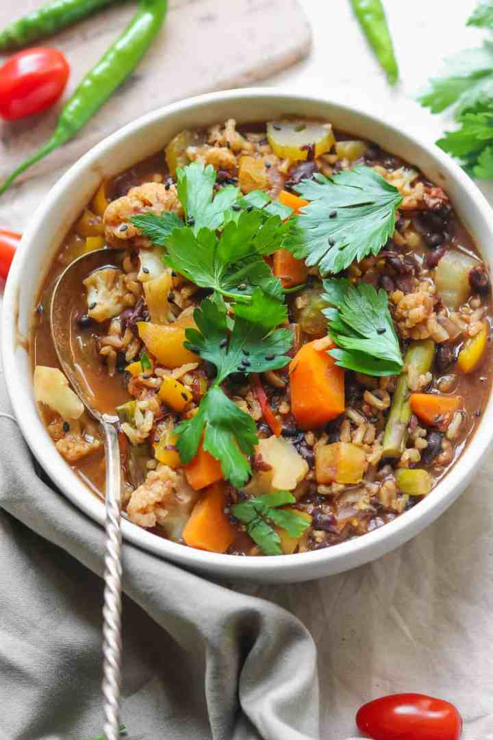 Oil-free healthy vegan black bean soup with rice and vegetables