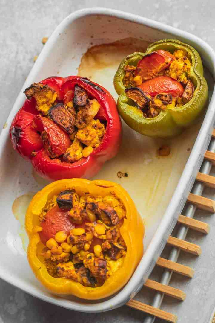 Vegan mushroom and tofu stuffed peppers in baking dish
