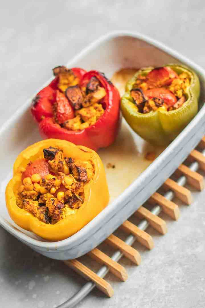 Mushroom and tofu stuffed peppers in a baking dish