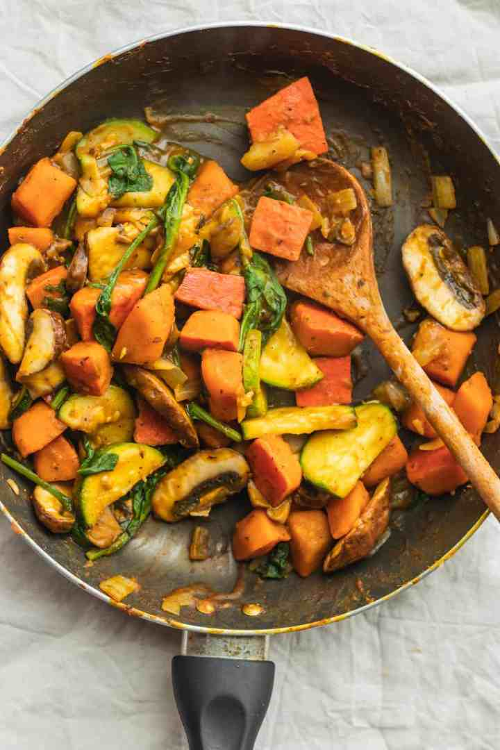 Easy vegan stir-fry with pumpkin and autumn vegetables in a frying pan