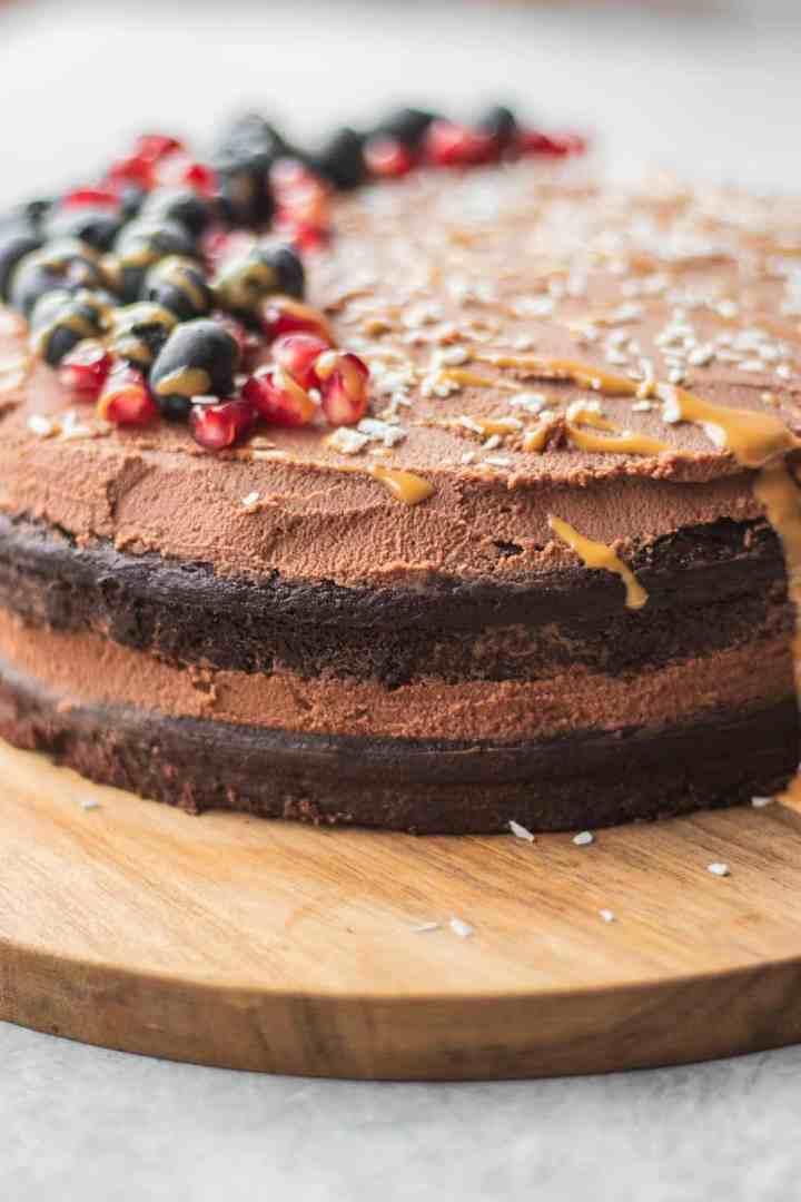 Gluten-free vegan chocolate cake with berries