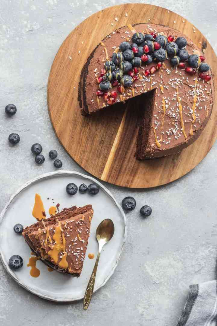 Gluten-free vegan chocolate cake with peanut butter and berries