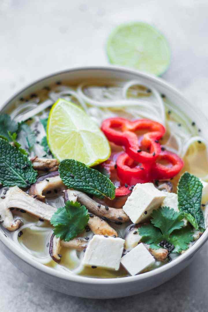 Pho with shiitake mushrooms and lime