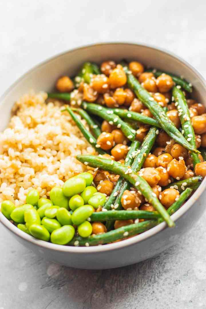 Bowl with sweet and sour chickpeas, green beans and edamame