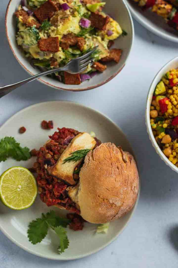 Vegan BBQ with burgers, potato salad and couscous
