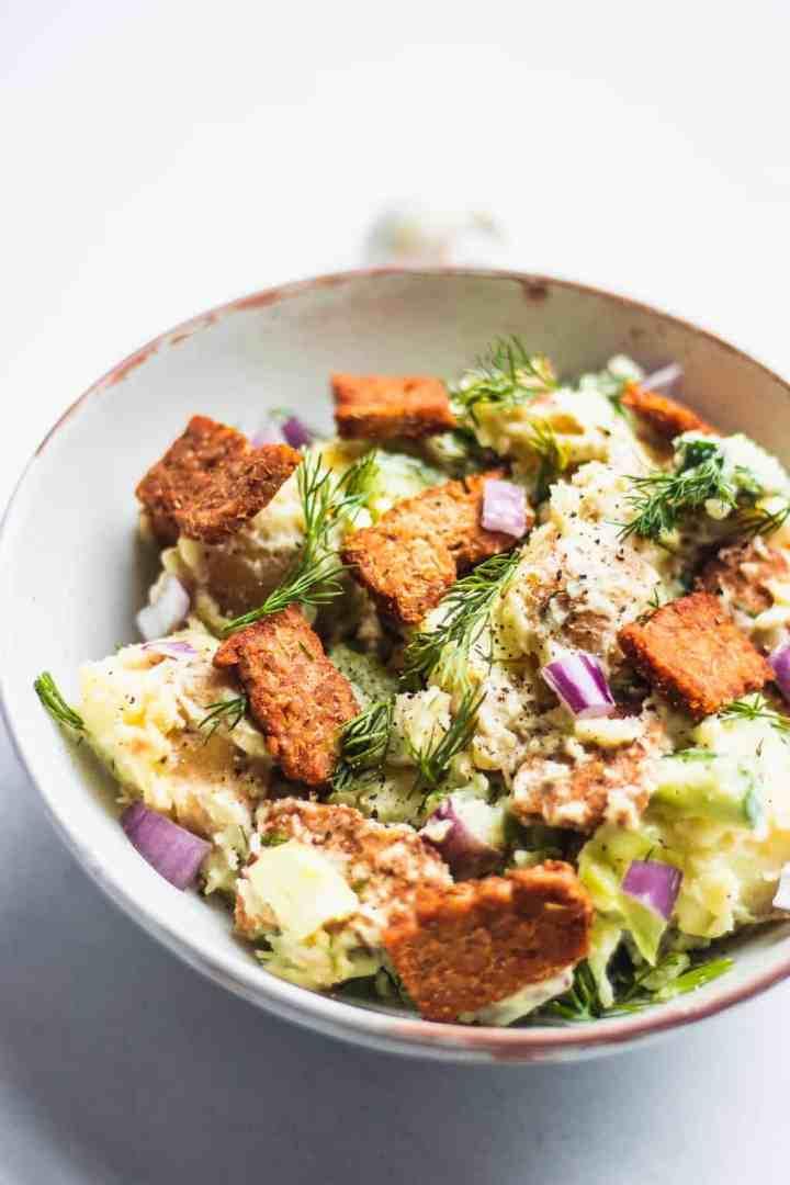 Plate of vegan potato salad and tempeh