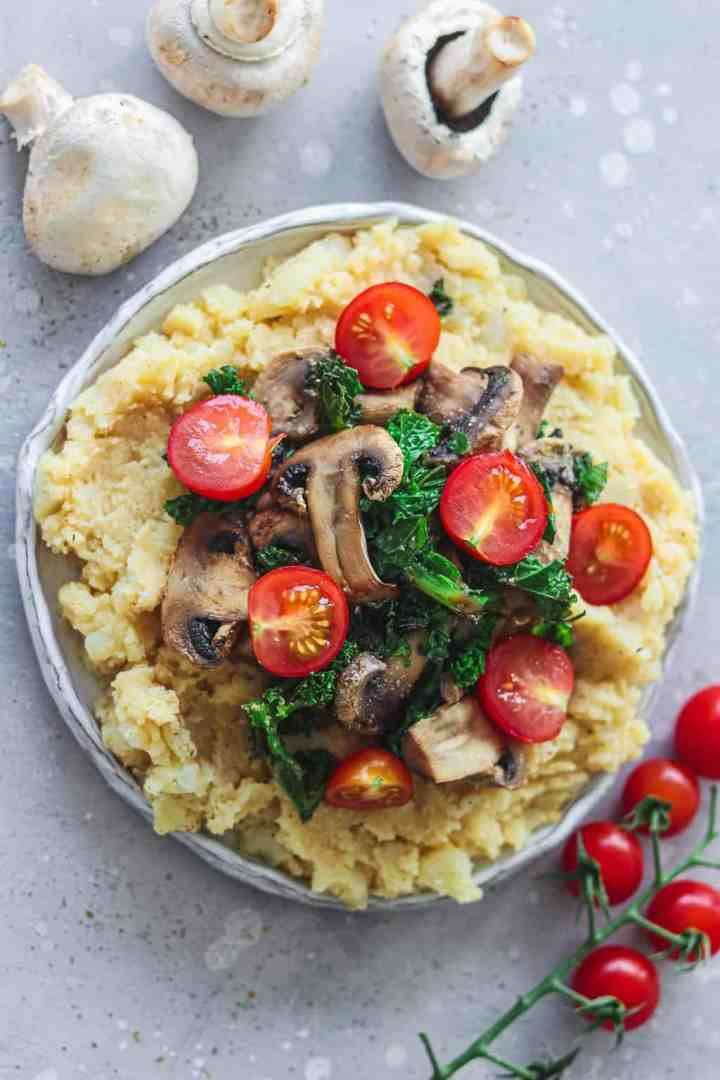 White plate with mashed potatoes and vegetables